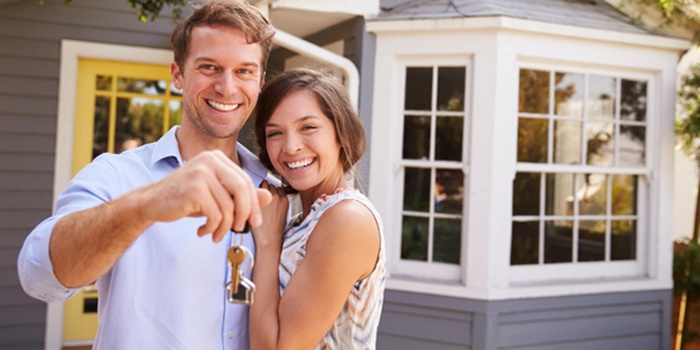 Husband and wife holding the keys of their new home