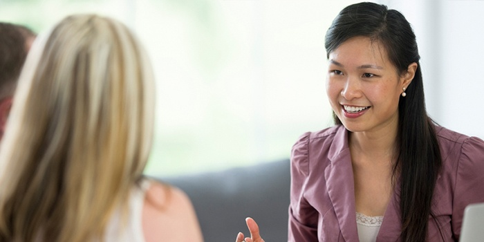 Two women talking about life insurance options