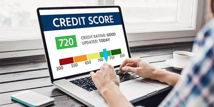Woman on the computer looking at her credit score