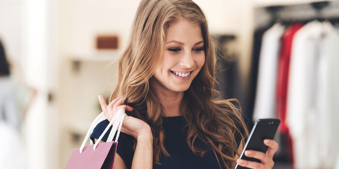 Girl shopping with phone in hand