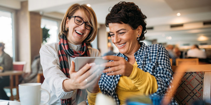 Two women looking at retirement planning strategies