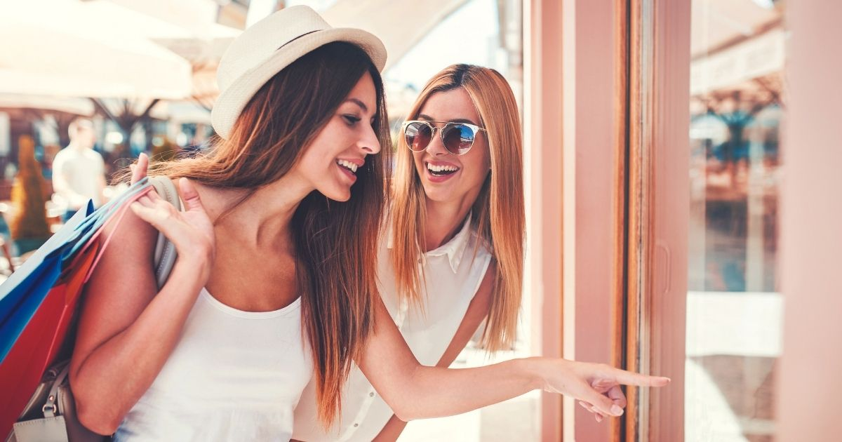 Friends use credit cards to shop