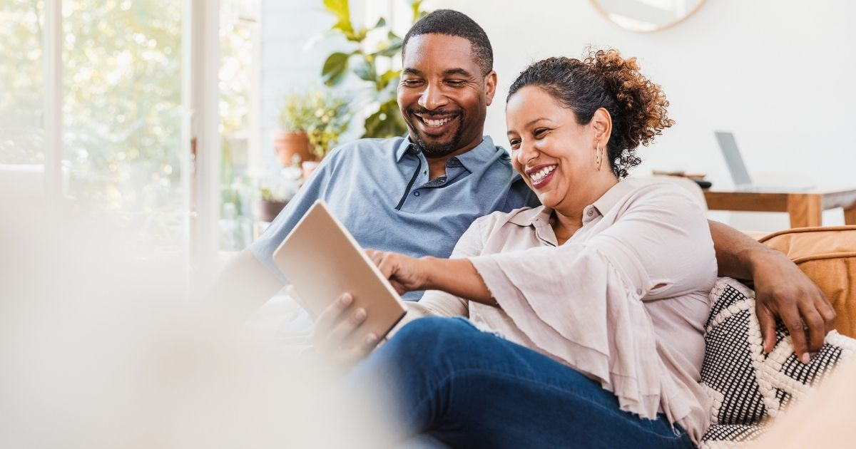 couple researching checking accounts